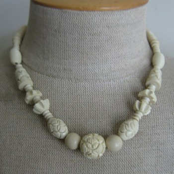 bone colored carved celluloid necklace