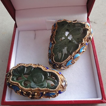 Two Chinese Enameled Carved Jade Brooches in silver filigree setting with gold gilt wash silver and cloisonné