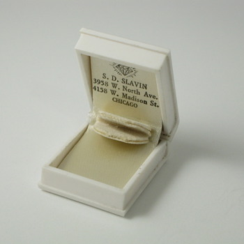 white book ring box with diamond logo and 2 store addresses