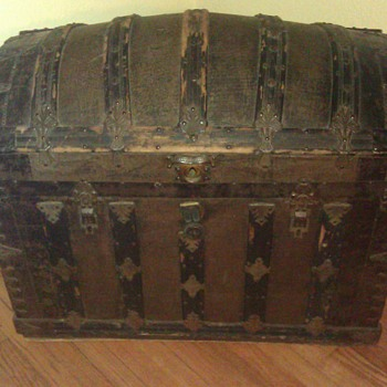 Antique trunk with name. Also name of lock company.
