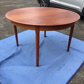 "Beautiful teak table! Marked  ""cjrosengaarden"" Help please!"