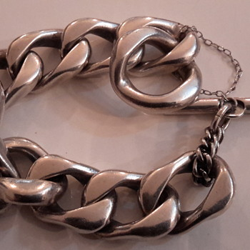 A vintage sterling silver bracelet & another