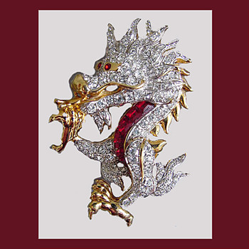 Gorgeous SWAROVSKI dragon brooch with swan logo.