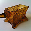 DAISY AND BUTTOM PATTERNED GLASS ANVIL OPEN SALT/TOOTHPICK HOLDER ANVIL SHAPED AMBER MARKED