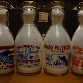 Cop the Cream milk bottles with war slogans on reverse.......
