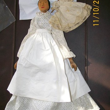 Example of hand carved wood dolls circa 1800's to 1900