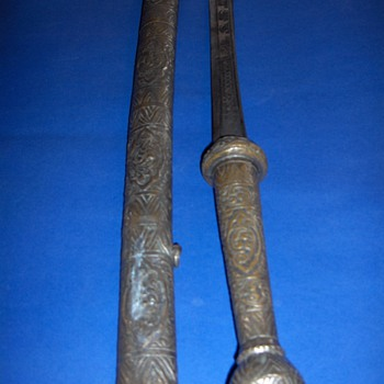 A Sword I found and I am clueless- Please Help
