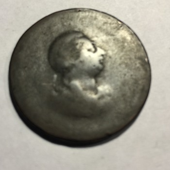 Unknown if this is a coin or token US great Britain or wherever ???