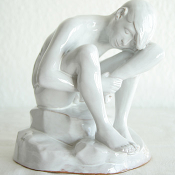 Mystery white glaze sculpture of a adolescent boy marked A.R.TH.