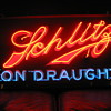 Neat old Schlitz Neon over porcelane sign.