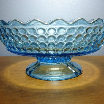 Blue glass footed candy dish. Has a mark but unable to find maker name.