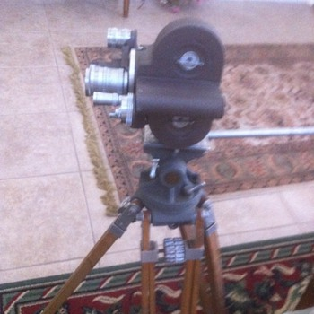 wooden movie tripod and camera