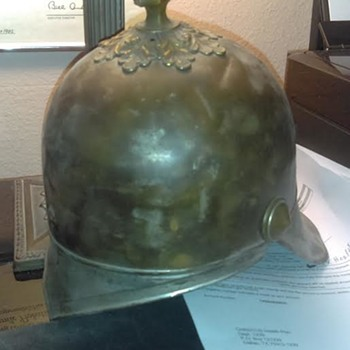 Helmet with a spike