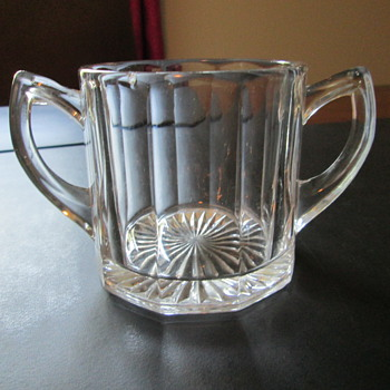 Paneled (fluted) open sugar bowl with starburst on bottom - depression glass?