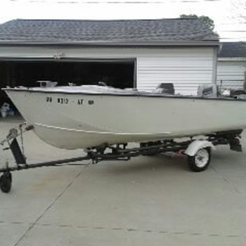 Boat  a 1958 Crestliner, 17&#039; Flying Crest with Gator trailer with 1962 Evinrude Lark IV