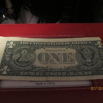 misaligned miscut dollar bill