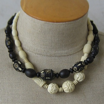 Black painted then carved and ivory-color carved celluloid 1930's necklaces