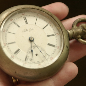 silver (?) heavy men's antique pocket watch with train engraving