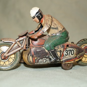 Motorcycle and sidecar tin toy