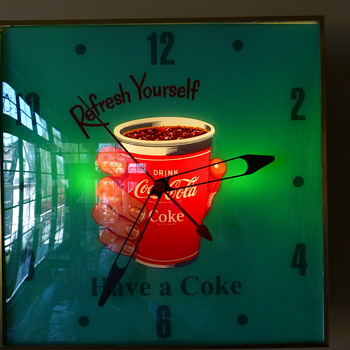 Coca-Cola Cup-in-hand Pam Clock