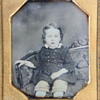 Sixth-Plate Daguerreotype Portrait of a Young Blue-Eyed Boy on Settee