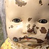 Tin head scary doll