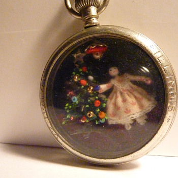 Doll inside Pocket Watch Case
