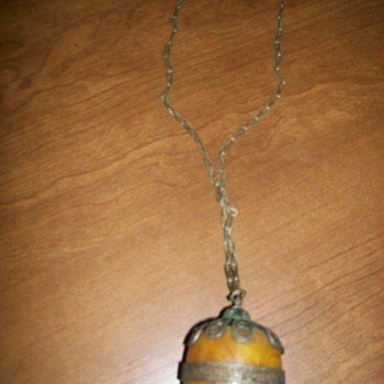 silver chain and amber,,, beeswax? 