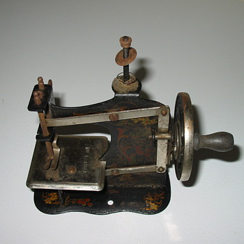 my mother's OLD toy sewing machine - Sewing