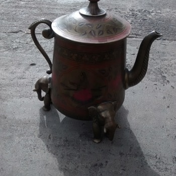 Brass Teapot with Elephant head feet with coloured decoration on  outer surface and lid.