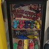 Old display case with old plastic toys