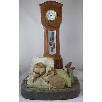 A Goldscheider Pottery Nursery Clock - A Child and Her Pet Rabbit circa 1900
