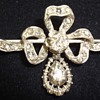 A silver and gold rose cut diamond Victorian bow brooch