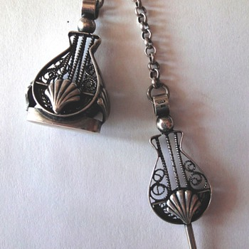 Antique silver filigree watch fob and key on Belcher chain