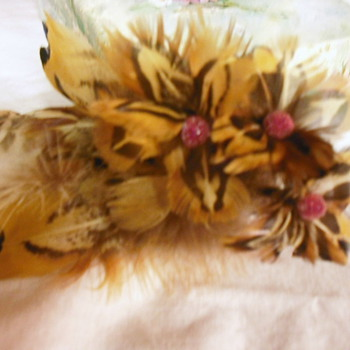 Vintage corsages, One feather the other a patriotic made with postage stamps.