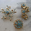 Mix of aqua rhinestone brooches and earrings from 50's-60's