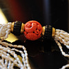Exceptional Early Cartier Carved Coral Bead, onyx and pearls necklace, with 18k solid gold mount