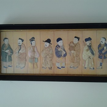 Can someone help me describe this oriental piece of art made  folded fabric figures with paper shoes and real hair.