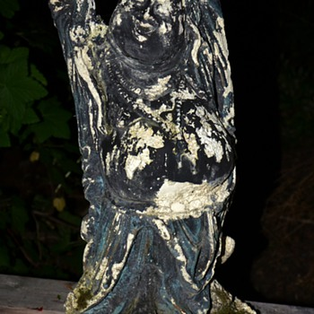 Weather worn and moss-covered Buddha - still happy! - Asian