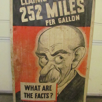 Claims 252 Miles to the Gallon Double Sided Cardboard Sign