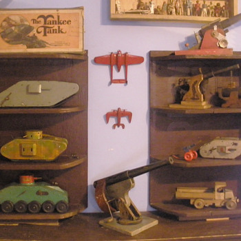 New military toy display. Grandfather&#039;s hand built shelves put to good use!