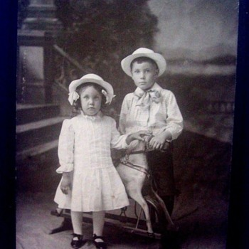 CHILDREN POSED WITH THEIR WONDERFUL ROCKING HORSE! BOY & GIRL WEAR SAME HAT.