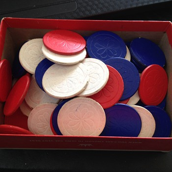 Old poker chips feels like painted cardboard