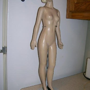 1940's mannequin showing restore of bent legs