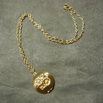 Odd Locket Containing Wax - Costume Jewelry
