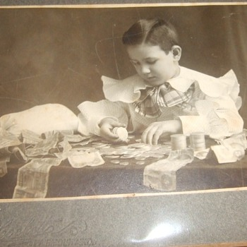Antique photograph of a boy banker with King of Bills - US Paper Money