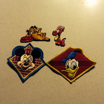 Micky mouse and Donald Duck vintage patches and other patches from around the world