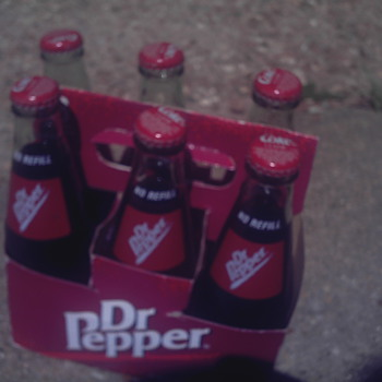 Dr Pepper bottles....but with Coke Classic caps!