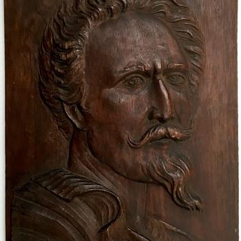 Wooden relief plaque