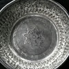 unidentified silver bowl with.8 pointed star and faces